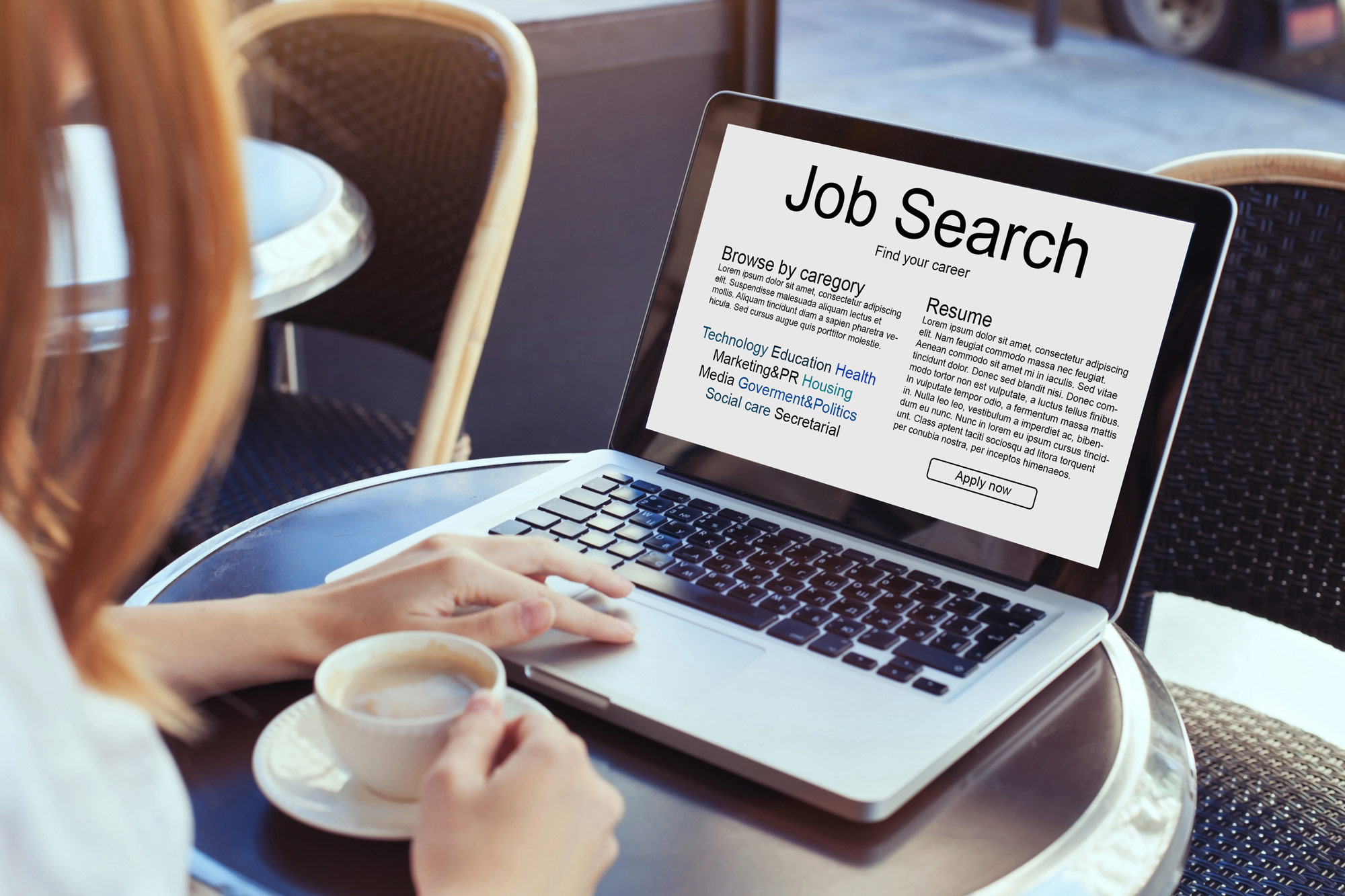 Image of person on computer searching for a job