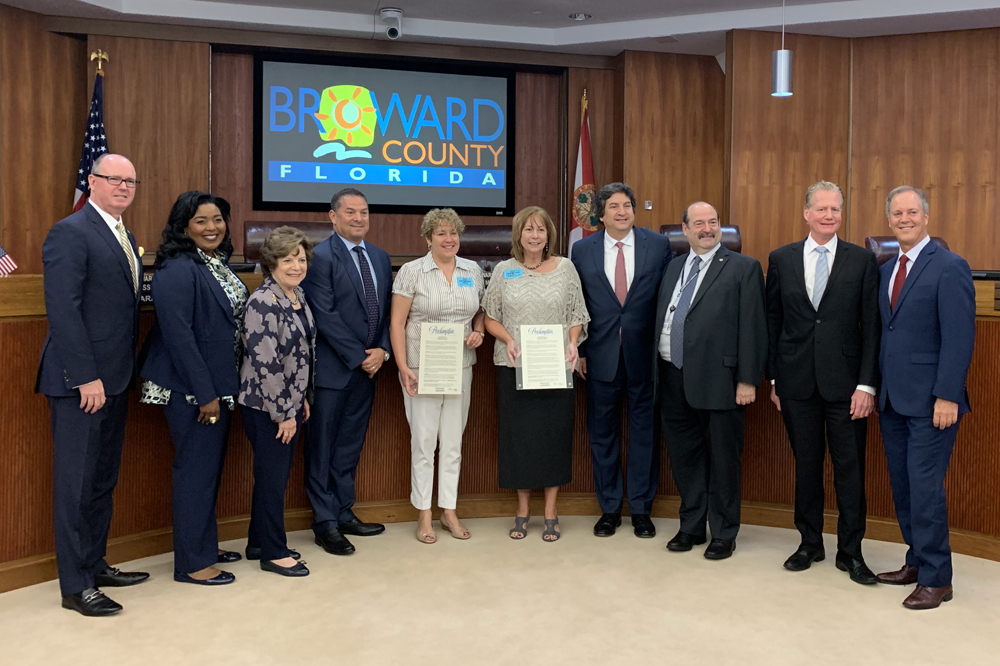 Sun Sentinel—Mayor Bogen presents a proclamation to Dana Banker and Rosemary O'Hara