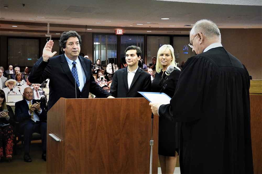 Mayor Bogen is sworn in as Mayor alongside his wife and son.