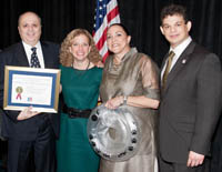 U.S. Rep. Debbie Wasserman Schultz (second from left) and Miguel Olivares (far right) congratulate the Colangelos.