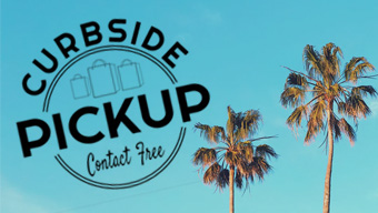 curbside pick up logo next to palm trees and blue sky