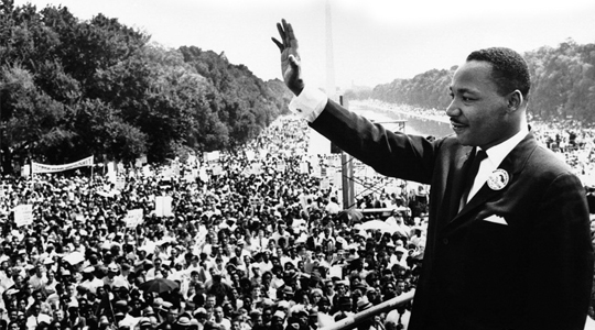 Dr. Martin Luther King, Jr. speaking to a large audience