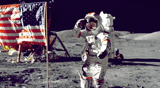 astronaut and us flag on moon