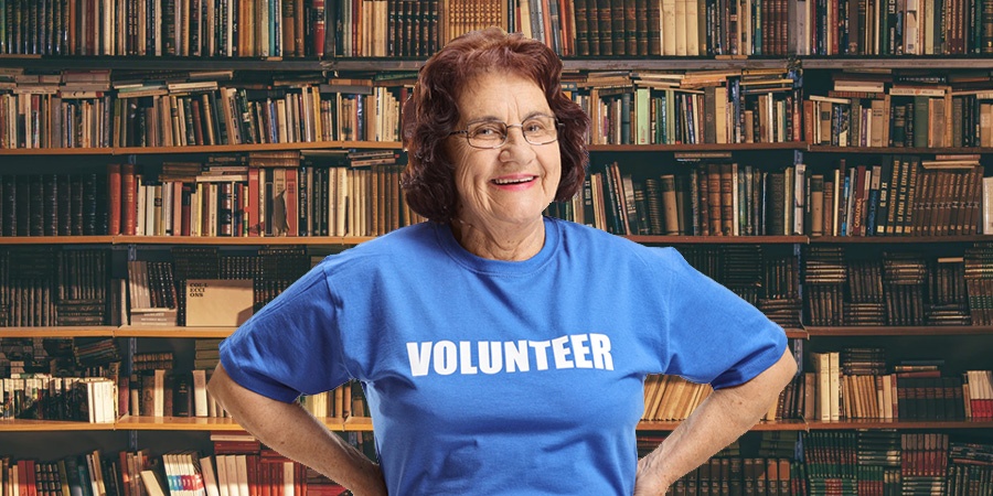 happy woman wearing volunteer shirt