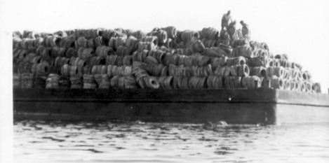 1970's barge loaded with tires
