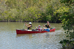 family canoeing at West Lake Park