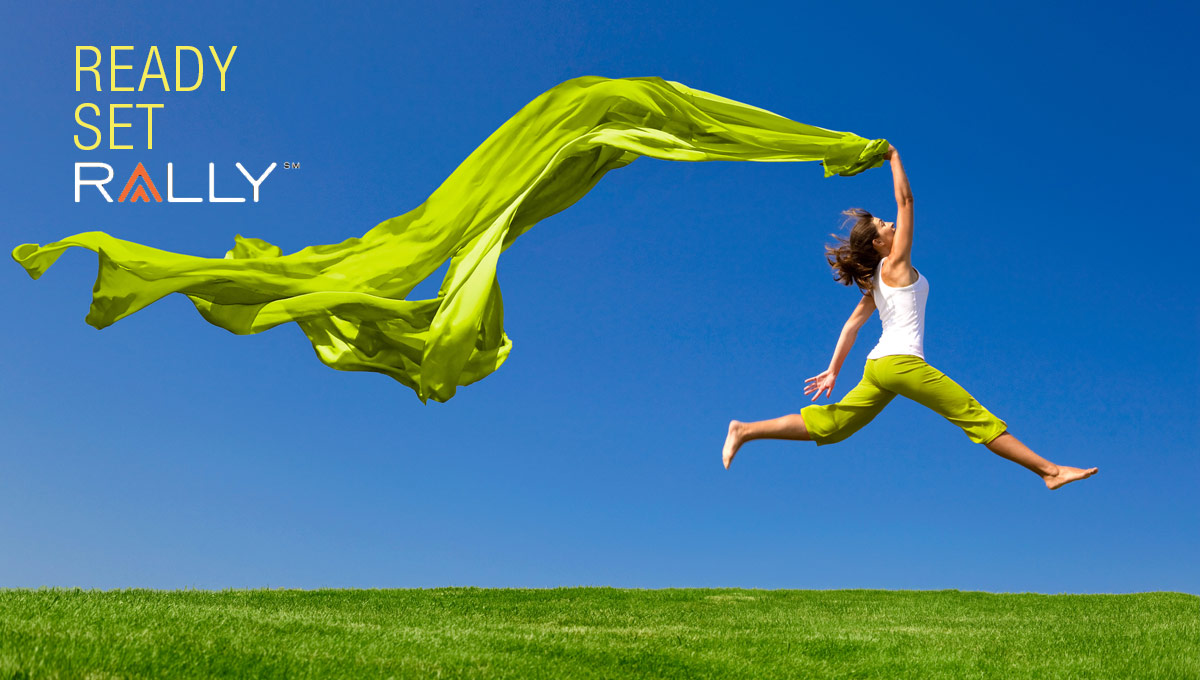 Image of a woman jumping with green pants